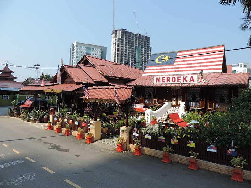 The kampung (village). Merdaka is Malay for independance