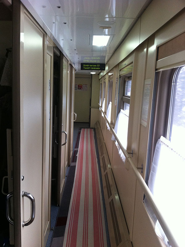 Corridor with doors to each compartment